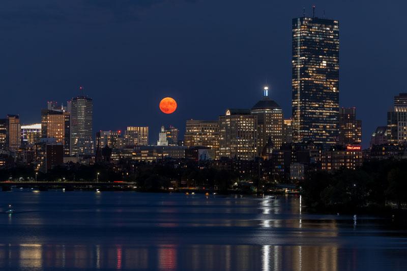 The Harvest Full Moon Rising Over the Boston Skyline